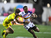 USA player Carlin Isles try to break a tackle in the game USA vs Australia during the USA Sevens Rugby Series at Sam Boyd Stadium, Las Vegas, USA on 2 March 2018. Picture by Ian  Muir.
