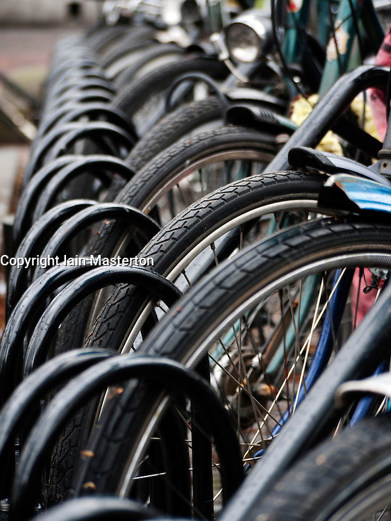 Many bicycles parked outside in rack in Utrecht The Netherlands