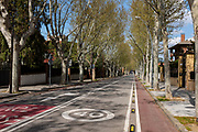 Normally busy street, Avinguda d Gracia, devoid of traffic. 21 March 2020 - one week into lockdown. Empty streets in Sant Cugat del Valles, a normally bustling city of some 90,000 people outside Barcelona,  a week after Spain exerted a state of Emergency to deal with the spread Coronavirus. Spain is one of the worst affected countries. Schools and retail businesses are closed, except for supermarkets and pharmacies.