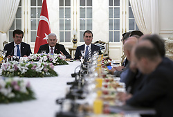 July 27, 2017 - Ankara, Turkey - July 27, 2017 - Ankara, Turkey - Turkish Prime Minister Binali Yildirim (C), EU Minister of Turkey Omer Celik (R) and Turkish Economy Minister Nihat Zeybekci (L) meet with German executives invested in Turkey in wake of German government's realignment of Turkey-Germany relationship at Cankaya Palace in Ankara, Turkey on July 27, 2017. Speaking at a meeting with the executives at the Çankaya Prime Ministry Office in Ankara, Yıldırım said that Turkey highly values their companies, in response to German Foreign Minister Sigmar Gabriel's statements urging firms to avoid doing business in Turkey. ''For us it is crucial to ensure that you do not sustain any damage or become a part of this tension'' Yıldırım said and added that they see German companies as part of Turkey. The prime minister assured companies that they do not pay the price for the problems between the two countries. Relations between Turkey and Germany, home to three million ethnic Turks, have been badly strained, particularly since the failed coup attempt a year ago against Turkey's democratically elected government by the Gülenist Terror Group (FETÖ). Turkey accuses Germany of harboring high-ranking FETÖ figures and soldiers linked to the coup attempt, in addition to activities of PKK and DHKP-C terrorist groups in Germany. (Credit Image: © Dha/Depo Photos via ZUMA Wire)