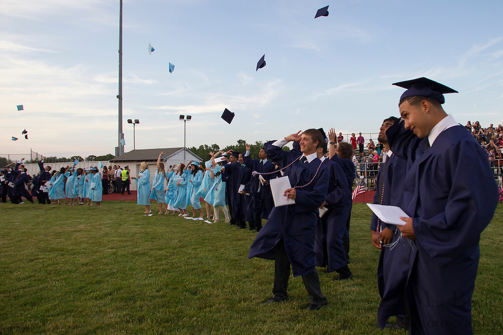 Graduates toss their caps in the air at the end of Highland Regional High School graduation on Thursdays June 14, 2012 . (photo / Mat Boyle)