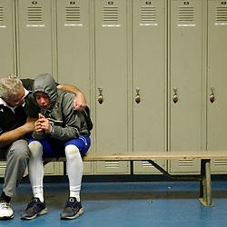 Charter Oak head coach Lou Farrar comforts his grandson Louis Farrar after Sierra Canyon defeated Charter Oak 42-19 during a CIF semifinal prep playoff football game at Charter Oak High School in Covina, Calif., on Friday, Nov. 25, 2016.