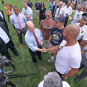 Former New York Yankees All-Star pitcher Mariano Rivera (RIGHT) shakes hands with U.S. Senator Christopher Coons (LEFT) during a backpack give-away sponsored by Mariano&quot; organization &quot;The Mariano Rivera Public Foundation&quot; Monday, August. 14 2017, at Rodney Square in Wilmington Delaware.<br /> <br /> More than 1,500 backpacks filled with back-to-school supplies was given to children in grades K through 5th grade.