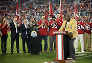 Former Tampa Bay Buccaneers defensive tackle Warren Sapp (99) is given his Pro Football Hall of Fame ring and jacket as a new member of that fraternity while he also is inducted into the Tampa Bay Buccaneers Ring of Honor at halftime of the NFL week 10 football game against the Miami Dolphins on Monday, Nov. 11, 2013 in Tampa, Fla.. The Buccaneers won the game 22-19. ©Paul Anthony Spinelli