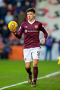 Aaron Hickey (#51) of Heart of Midlothian FC takes a throw in during the Ladbrokes Scottish Premiership match between Heart of Midlothian FC and Aberdeen FC at Tynecastle Stadium, Edinburgh, Scotland on 29 December 2019.