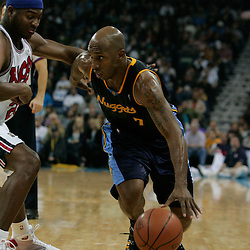 28 January 2009:  Denver Nuggets guard Chauncey Billups (7) drives past New Orleans Hornets guard Devin Brown (23) during a 94-81 win by the New Orleans Hornets over the Denver Nuggets at the New Orleans Arena in New Orleans, LA. The Hornets wore special throwback uniforms of the former ABA franchise the New Orleans Buccaneers for the game as they honored the Bucs franchise as a part of the NBA's Hardwood Classics series. .