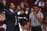 November 14, 2014; Stanford, CA, USA; Stanford Cardinal head coach Johnny Dawkins (left) argues with a NCAA official during the second half against the Wofford Terriers at Maples Pavilion.