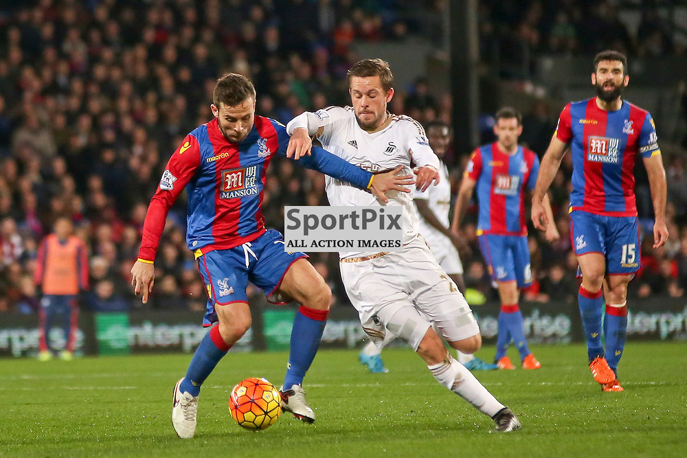 Yohan Cabaye of Crystal Palace holds off Gylffi Sigurdsson of Swansea City During Crystal Palace vs Swansea on Monday the 28th December 2015.