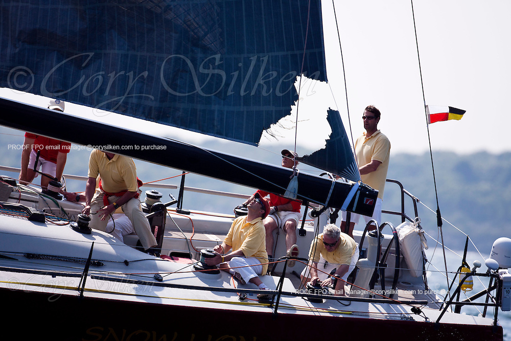 Snow Lion, class 9, reefing their main sail because of a torn clew  at the start of the Newport Bermuda Race 2010. The race began in Newport, Rhode Island on June 18, 2010.