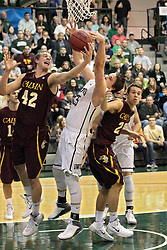 14 March 2014:  Tyler Kruis, Andrew Ziemnik, & Brad Visser during an NCAA mens division 3 quarter final basketball game between the Calvin Knights and the Illinois Wesleyan Titans in Shirk Center, Bloomington IL