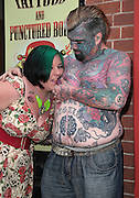 """EXCLUSIVE<br /> Britain's most tattooed man """"King Of Ink Land"""" has had is nipple removed in this latest bizarre twist King of ink as he is now known<br /> spent friday morning having his nipple removed,<br /> <br /> King of ink said """"I have never really found my nipples attractive. In fact I just didn't like them. My girlfriend will miss them as she use to enjoy biting them something that comes a little bit erotica, However I am pleased to finally have them removed. It was not in the least painful however the next week or two I will be a,little sore.<br /> <br /> he went to say<br /> <br /> We will always respect our bodies.<br /> <br /> We believe it is our right to explore our world, both physical and supernatural, through spiritual body modification.<br /> <br /> We promise to always grow as individuals through body modification and what it can teach us about who we are and what we can do.<br /> <br /> We vow to share our experiences openly and honestly in order to promote growth in mind, body, and soul.<br /> <br /> We honor all forms of body modification and those who choose to practice in safe and consensual ways.<br /> <br /> We also promise to respect those who do not choose body modification.<br /> <br /> We support all that join us in our mission and help those seeking us in need of spiritual guidance.<br /> <br /> We strive to share a positive message with everyone we encounter, in order to act as positive role models for future generations in the body modification community.<br /> <br /> We always uphold basic codes of ethics and encourage others to do the same.<br /> when asked about his latest body transformation he replied <br /> <br /> """"I may practice rituals and body modification without prejudice or discrimination. By acting responsibly and with integrity, I wish to observe our sincerely held religious beliefs without restriction""""<br /> <br /> Photo shows: King if Ink pictured with his girlfried """"Queen of Ink Land""""<br /> ©Exclusivepix"""