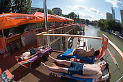 """The """"Badeschiff"""", a brand new, floating public bath anchored at the Donaukanal (Danube Channel) near Urania."""