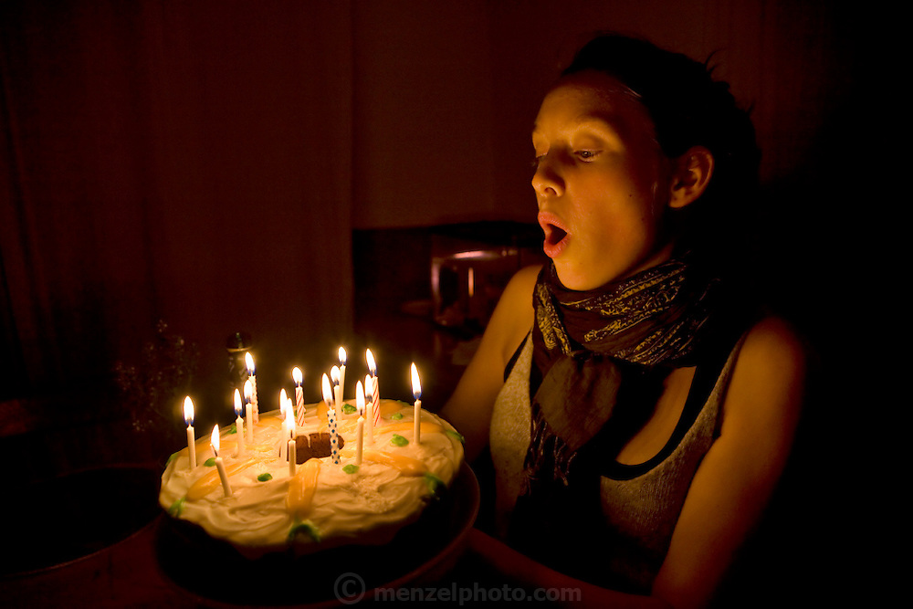 Coco Simone Finken, a teenage vegetarian who lives in the city of Gatineau*, Quebec blows birthday candles on a homemade carrot cake baked by her mother and sister. (From the book What I Eat: Around the World in 80 Diets.) The caloric value of her day's worth of food on a typical day in the month of October was 1900 kcals. She is 16 years of age; 5 feet, 9.5 inches tall; and 130 pounds. The family doesn't own a car, buys organic food if it's not too expensive, and grows some of their own vegetables in their front yard. MODEL RELEASED