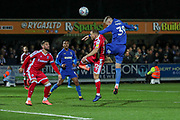 AFC Wimbledon striker Joe Pigott (39) beating Gillingham defender Barry Fuller (12) to a header during the EFL Sky Bet League 1 match between AFC Wimbledon and Gillingham at the Cherry Red Records Stadium, Kingston, England on 23 November 2019.