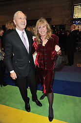 PATTI BOYD and PETER BROWN arrive at the press night of the new Andrew Lloyd Webber  musical 'The Wizard of Oz' at The London Palladium, Argylle Street, London on 1st March 2011 followed by an aftershow party at One Marylebone, London NW1
