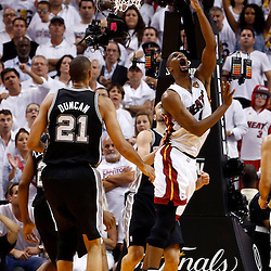 Jun 18, 2013; Miami, FL, USA; Miami Heat center Chris Bosh (1) shoots against the San Antonio Spurs during overtime in game six in the 2013 NBA Finals at American Airlines Arena. The Heat won 103-100 in overtime. Mandatory Credit: Derick E. Hingle-USA TODAY Sports