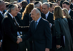 60917089<br />  Israeli President Shimon Peres (2nd L) shakes hands with Quartet representative and former British Prime Minister Tony Blair during a state memorial ceremony of former Israeli Prime Minister Ariel Sharon at Israel s Knesset (parliament) in Jerusalem, on Jan. 13, 2014.The memorial events for late Israeli Prime Minister Ariel Sharon, who died on Saturday, were underway on Monday morning with a memorial ceremony held in front of the Knesset (Israeli parliament) building, Monday, 13th January 2014. Picture by  imago / i-Images<br /> UK ONLY
