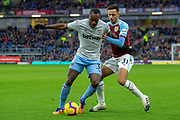 West Ham United midfielder Michail Antonio (30) battles with Burnley forward Dwight McNeil (31) during the Premier League match between Burnley and West Ham United at Turf Moor, Burnley, England on 30 December 2018.