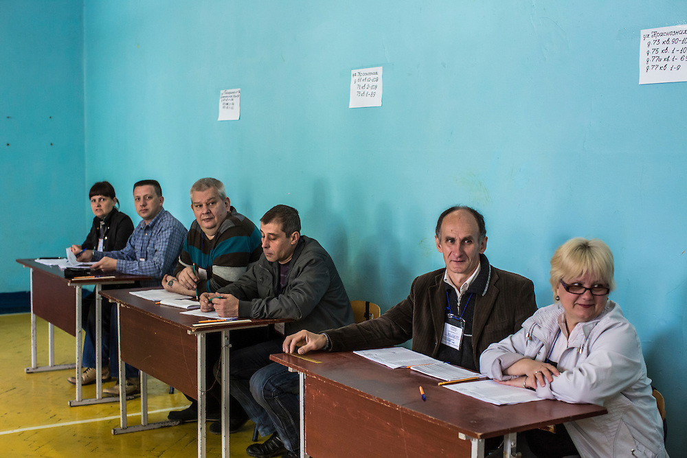 HARTSIZK, UKRAINE - MAY 11: Workers at a polling station wait to check in voters on May 11, 2014 in Hartsizk, Ukraine. A referendum on greater autonomy is being held after pro-Russian activists took over at least ten cities in the eastern part of the country in a bid for less control from the central government from Kiev. (Photo by Brendan Hoffman/Getty Images) *** Local Caption ***