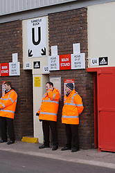 LIVERPOOL, ENGLAND - Saturday, January 26, 2008: Stewards stand outside a turnstile at the Main Stand in Anfield. (Photo by David Rawcliffe/Propaganda)