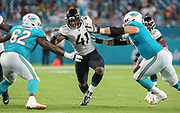 Aug 22, 2019; Miami Gardens, FL USA;  Jacksonville Jaguars defensive end and first round draft pick Josh Allen (41) breaks through the Miami offensive line during an NFL preseason game at Hard Rock Stadium. The Dolphins beat the Jaguars 22-7. (Kim Hukari/Image of Sport)