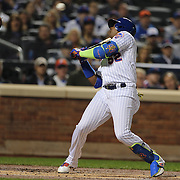 NEW YORK, NEW YORK - October 5: Yoenis Cespedes #52 of the New York Mets avoids a high pitch from pitcher Madison Bumgarner #40 of the San Francisco Giants in the first inning during the San Francisco Giants Vs New York Mets National League Wild Card game at Citi Field on October 5, 2016 in New York City. (Photo by Tim Clayton/Corbis via Getty Images)