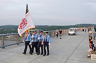Highland, New York - Members of the Pleasant Valley Fire Department march from the Poughkeepsie side of the Walkway over the Hudson on May 27, 2012. A Memorial Day ceremony was held by the American flag at the center of the walkway at dusk.