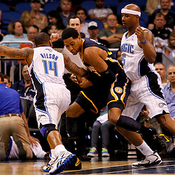 March 11, 2012; Orlando, FL, USA; Indiana Pacers small forward Danny Granger (33) is defended by Orlando Magic point guard Jameer Nelson (14) and small forward Quentin Richardson (5) during the first quarter of a game at  Amway Center.   Mandatory Credit: Derick E. Hingle-US PRESSWIRE