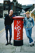 Mark Goddard and Nigel Busby by a pillarbox, High Wycombe, UK, 1980s.