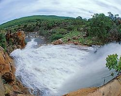 Wet season view of a waterfall in Dugong Bay
