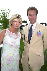 BARONESS VAN ZUYLEN and MR ADRIAN DANGER, at a polo match in Berkshire on 30th July 2000.OGN 57