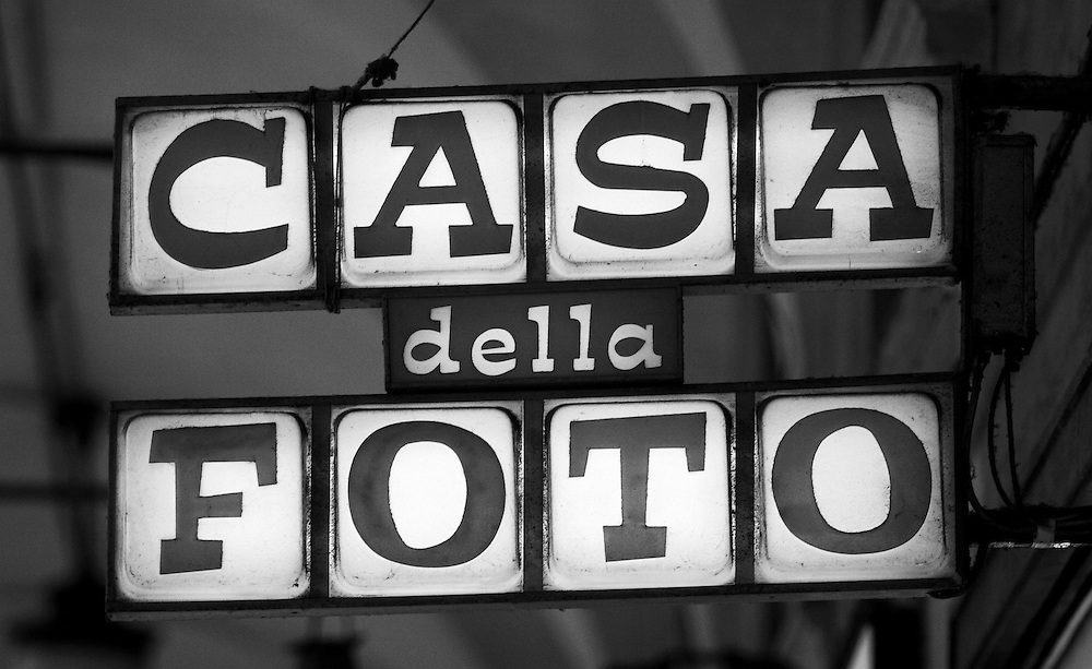"Black and white photography of a photo sign from Italy by Karl R Lilliendahl photographer. Photograph is available as open edition and limited edition giclee print in four sizes. Click on ""Get Print"" to see more details."