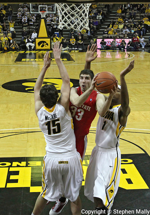 January 04 2010: Ohio State Buckeyes guard Jon Diebler (33) tries to shoot through Iowa Hawkeyes forward Zach McCabe (15) and forward Melsahn Basabe (1) during the first half of an NCAA college basketball game at Carver-Hawkeye Arena in Iowa City, Iowa on January 04, 2010. Ohio State defeated Iowa 73-68.