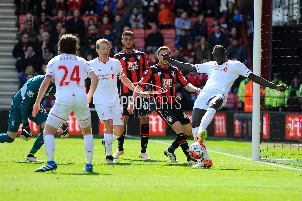 Liverpool defender Mamadou Sakho clears the ball from the 6 yard box after Bournemouth pressure during the Barclays Premier League match between Bournemouth and Liverpool at the Goldsands Stadium, Bournemouth, England on 17 April 2016. Photo by Graham Hunt.