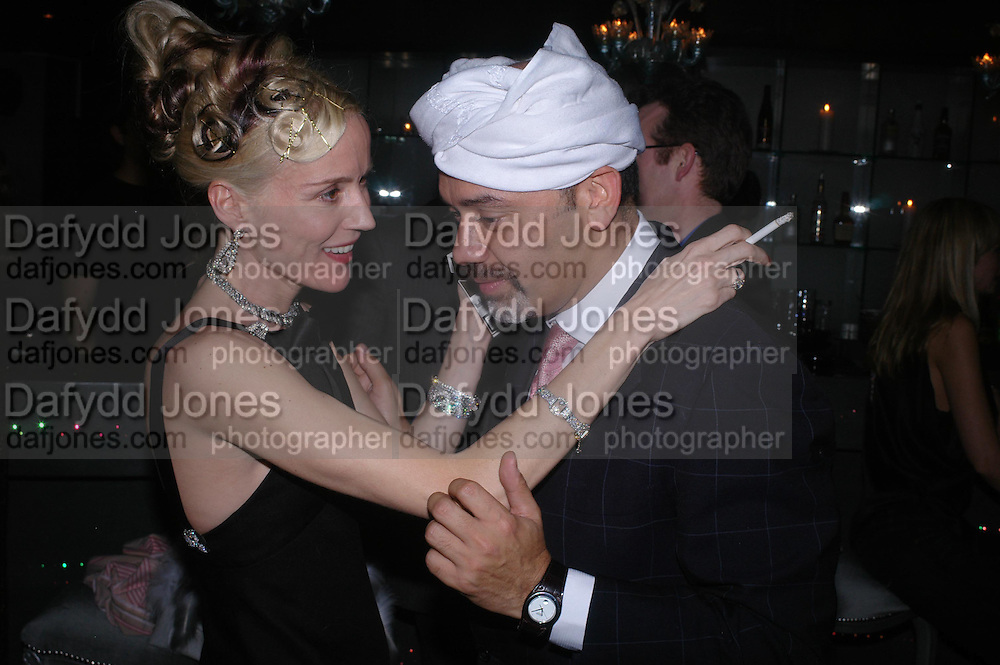 Daphne Guinness and Christian Louboutin, party given by Daphne Guinness for Christian Louboutin  after the opening of his new shopt.  Baglione Hotel. 16 March 2004.  ONE TIME USE ONLY - DO NOT ARCHIVE  © Copyright Photograph by Dafydd Jones 66 Stockwell Park Rd. London SW9 0DA Tel 020 7733 0108 www.dafjones.com