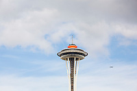 The Seattle space needle with a plane or jet in the scene