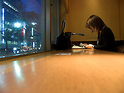 girl reading a book in a coffee bar Okachimachi Tokyo