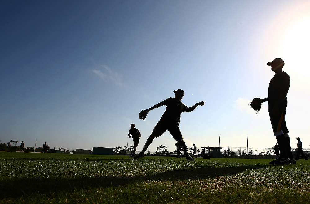 Feb 12, 2013; Bradenton, FL, USA;  Members of the Pittsburgh Pirates warmup during spring training at Pirate City.