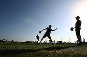 Feb 12, 2013; Bradenton, FL, USA;  Members of the Pittsburgh Pirates warmup during spring training at Pirate City.