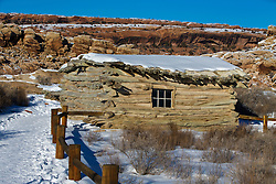 Log cabin at Wolfe Ranch, with snow on the ground, Arches National Park, Utah, United States of America
