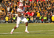 November 02 2013: Wisconsin Badgers running back Melvin Gordon (25) on a run during the second half of the NCAA football game between the Wisconsin Badgers and the Iowa Hawkeyes at Kinnick Stadium in Iowa City, Iowa on November 2, 2013. Wisconsin defeated Iowa 28-9.