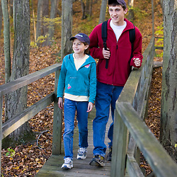A brother and sister on a nature walk at Massachusetts Audubon Society's Arcadia Wildlife Sanctuary in Northampton, Massachusetts.