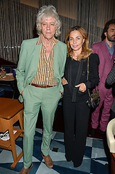 BOB GELDOF and his wife JEANNE at a dinner to celebrate the start of The Season held at Rivea, Bulgari Hotel, 171 Kightsbridge, London on 18th May 2016.