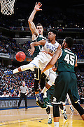INDIANAPOLIS, IN - NOVEMBER 18: Quinn Cook #2 of the Duke Blue Devils passes between Gavin Schilling #34 and Denzel Valentine #45 of the Michigan State Spartans during the Champions Classic basketball event at Bankers Life Fieldhouse on November 18, 2014 in Indianapolis, Indiana. The Blue Devils defeated the Spartans 81-71. (Photo by Joe Robbins)