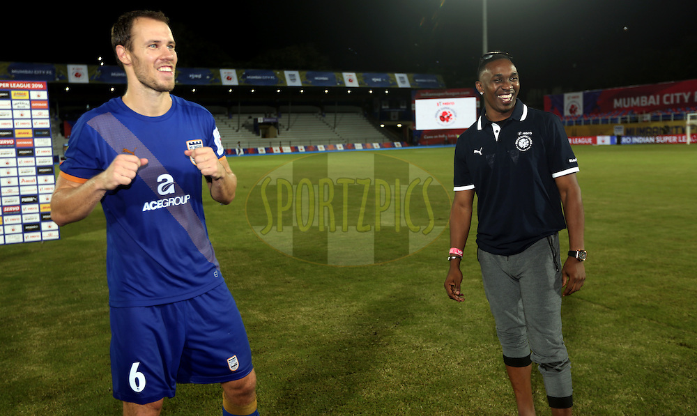 Krisztian Vadocz of Mumbai City FC and  Dwyen Bravo west indies cricket player after the match 7 of the Indian Super League (ISL) season 3 between Mumbai City FC and NorthEast United FC held at the Mumbai Football Arena in Mumbai, India on the 7th October 2016.<br /> <br /> Photo by Sandeep Shetty / ISL/ SPORTZPICS