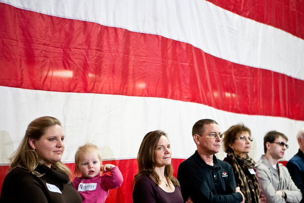 Audience members listen as Republican presidential candidate Mitt Romney speaks at a town hall meeting at the Diamond V South Plant on Friday, December 9, 2011 in Cedar Rapids, IA.