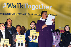 London, October 23 2017. Nelson Mandela's group of Elders including former UN Secretary General Kofi Annan and Secretary General Ban Ki-moon accompanied by his widow Graca Machel gather at Parliament Square at the start of the Walk Together event in memory of Nelson Mandela before a candlelight vigil at his statue in Parliament Square. &quot;WalkTogether is a global campaign to inspire hope and compassion, celebrating communities working for the freedoms that unite us&quot;. PICTURED: Mandela's widow Graca Machel addresses the crowd in Trafalgar Square.<br />  &copy; Paul Davey