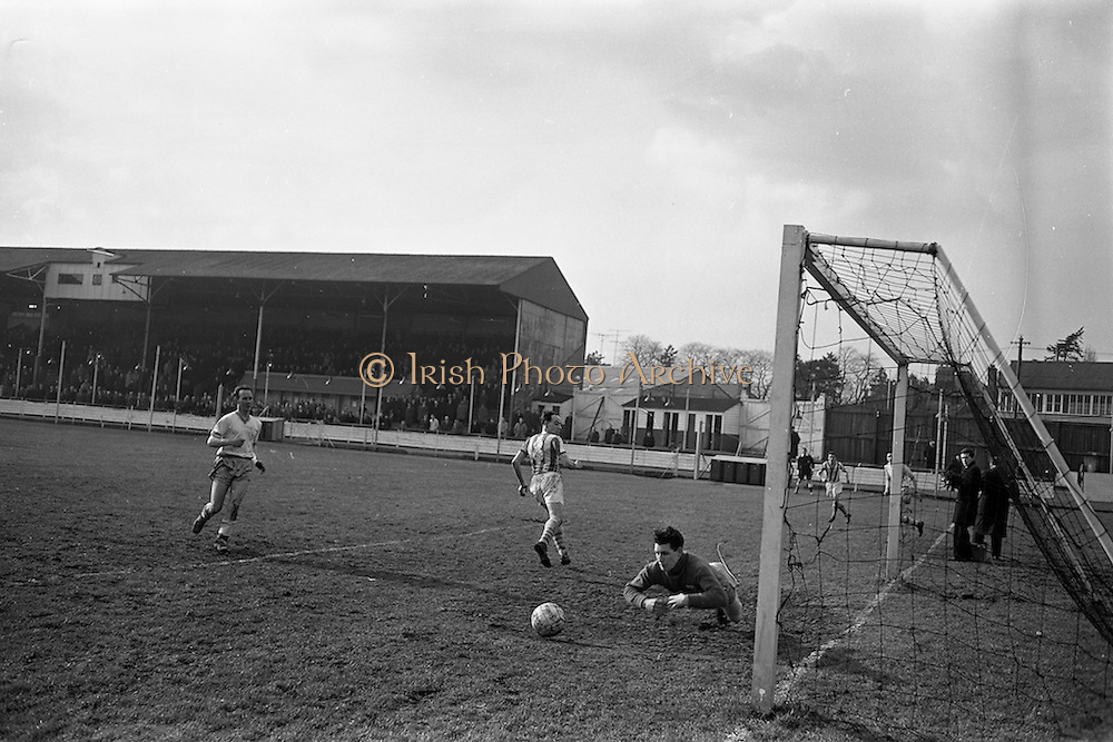 17/02/1963<br /> 02/17/1963<br /> 17 February 1963<br /> Soccer: Transport v Cobh Ramblers at Harold's Cross, Dublin.<br /> Ramblers goalie O'Conner goes full length to save a shot from Bennett (no.8) of Transport.