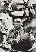"""Carl Mydans<br /> LIFE Magazine<br /> Korean War refugees 1950<br /> <br /> Korean mother nursing her baby as she transports all her belongings in a washbasin balanced on her head while retreating southward from Seoul. This photograph was published in the January 15, 1951 issue of LIFE Magazine, page 20.<br /> <br /> Details:<br /> Large format exhibition printed by the LIFE magazine photo lab sometime in the 1970s or 1980s. Also on the reverse in pencil is the photographer's photo credit and number """"825"""".<br /> <br /> This is a confirmed Mydans image and can be viewed in the LIFE Picture Collection online archive.<br /> <br /> - Double weight gelatin silver fiber print. <br /> - Size: 14 x 9 3/4 inches.<br /> <br /> Price ¥50,000 JPY<br /> <br /> <br /> <br /> <br /> <br /> <br /> <br /> <br /> <br /> <br /> <br /> <br /> <br /> <br /> <br /> <br /> <br /> <br /> <br /> <br /> <br /> <br /> <br /> <br /> <br /> <br /> <br /> <br /> <br /> <br /> <br /> <br /> <br /> <br /> <br /> <br /> <br /> <br /> <br /> <br /> <br /> <br /> <br /> <br /> <br /> <br /> <br /> <br /> <br /> <br /> <br /> <br /> <br /> <br /> <br /> <br /> <br /> <br /> <br /> <br /> <br /> <br /> <br /> <br /> <br /> <br /> <br /> <br /> <br /> <br /> <br /> <br /> <br /> <br /> <br /> <br /> <br /> <br /> <br /> <br /> <br /> <br /> ."""