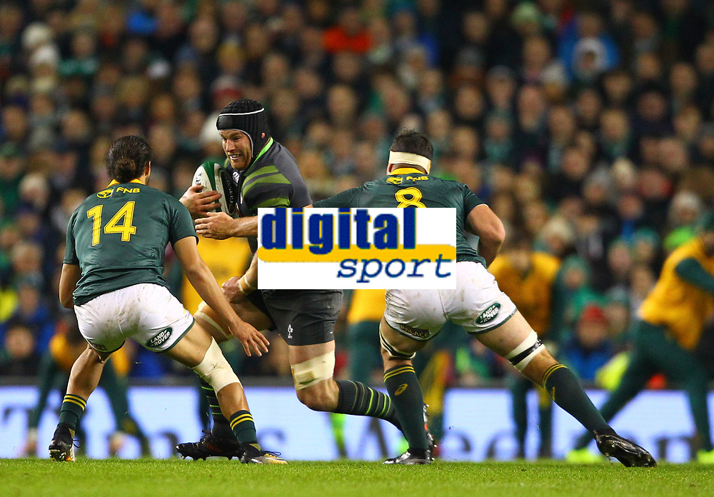 Rugby Union - 2017 Guinness Series (Autumn Internationals) - Ireland vs. South Africa<br /> <br /> Ireland's Sean O'Brien in action against South Africa's Dillyn Leyds and Francois Louw  at the Aviva Stadium.<br /> <br /> COLORSPORT/KEN SUTTON